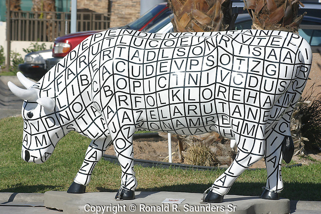 CowParade is an international public art exhibit that has been featured in major world cities. Fiberglass sculptures of cows are decorated by local artists, and distributed over the city centre, in public places such as train stations, important avenues, and parks. They often feature artwork and designs specific to local culture, as well as city life and other relevant themes.