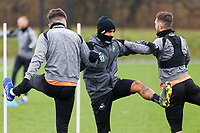 Yan Dhanda (C) and Matt Grimes (R) in action during the Swansea City Training Session at The Fairwood Training Ground, in Swansea, Wales, UK. Wednesday 06 March 2019