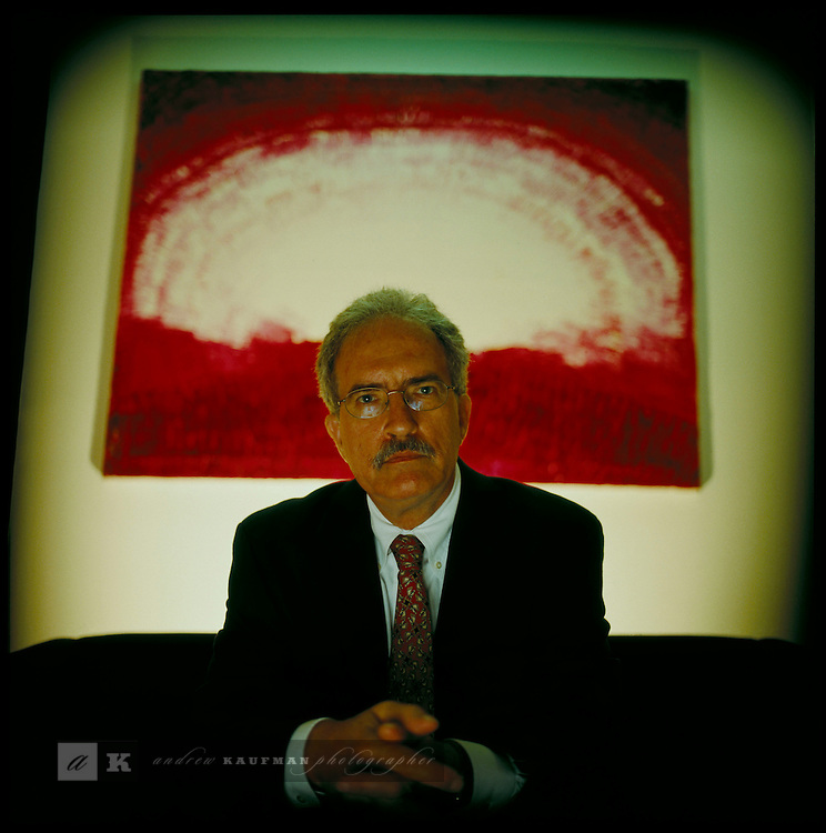 Santiago Leon an insurance salesman is also and anti-war and living wage activist. Here he is in his office on Brickell Avenue, Miami.