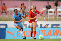 Allie Long (9) of the Washington Freedom is chased by Rosana (11) of Sky Blue FC. Sky Blue FC and the Washington Freedom played to a 0-0 tie during a Women's Professional Soccer (WPS) match at Yurcak Field in Piscataway, NJ, on July 7, 2010.