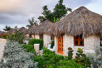 The Spa Retreat boutique hotel cottages with thatched roof.