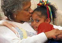 African-american grandmother kisses granddaughter