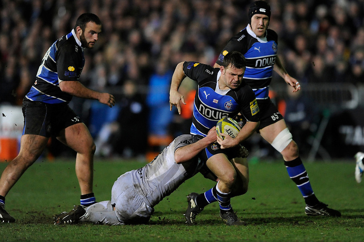 Lee Mears of Bath Rugby is tackled during the LV= Cup semi final match between Bath Rugby and Leicester Tigers at The Recreation Ground, Bath (Photo by Rob Munro, Fotosports International)