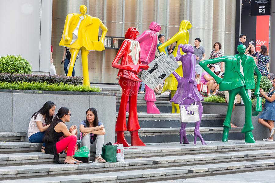 Women Sitting by Modern Fashion Sculptures outside ION Mall, Singapore, Orchard Road Street Scene.  Urban People by Kurt Lorenz Metzler.