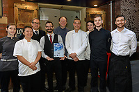 Melbourne, August 1, 2018 - The staff of Philippe Restaurant pose for a photograph with the winner's trophy from Saveur Awards at Philippe Restaurant in Melbourne, Australia. Photo Sydney Low