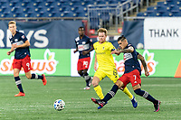 FOXBOROUGH, MA - OCTOBER 3: Gustavo Bou #7 of New England Revolution passes the ball as Dax McCarty #6 of Nashville SC defends during a game between Nashville SC and New England Revolution at Gillette Stadium on October 3, 2020 in Foxborough, Massachusetts.