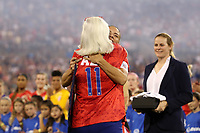 CHARLOTTE, NC - OCTOBER 3: Ali Krieger #11 of the United States hugs her mother while being honored for playing 100 games for the national team during a game between Korea Republic and USWNT at Bank of America Stadium on October 3, 2019 in Charlotte, North Carolina.