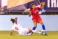 PHILADELPHIA, PA - AUGUST 29: Ana Borges #9 of Portugal tackles Christen Press #23 of the United States during a game between Portugal and the USWNT at Lincoln Financial Field on August 29, 2019 in Philadelphia, PA.