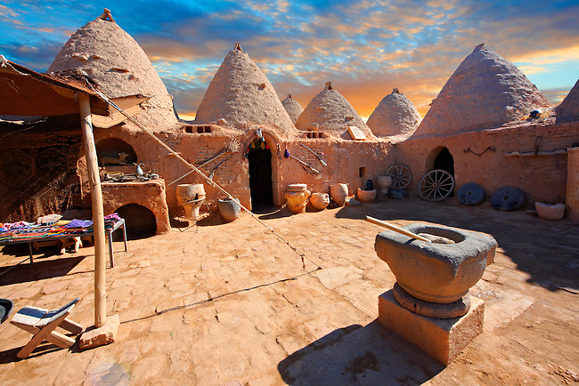 """Pictures of the beehive adobe buildings of Harran, south west Anatolia, Turkey.  Harran was a major ancient city in Upper Mesopotamia whose site is near the modern village of Altınbaşak, Turkey, 24 miles (44 kilometers) southeast of Şanlıurfa. The location is in a district of Şanlıurfa Province that is also named """"Harran"""". Harran is famous for its traditional 'beehive' adobe houses, constructed entirely without wood. The design of these makes them cool inside. 26"""