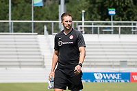 CARY, NC - SEPTEMBER 12: Portland Thorns assistant coach Rich Gunney checks out the pitch before a game between Portland Thorns FC and North Carolina Courage at WakeMed Soccer Park on September 12, 2021 in Cary, North Carolina.