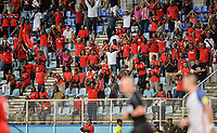 Couva, Trinidad & Tobago - Tuesday Oct. 10, 2017: Soca Warriors fans celebrate their win over the US during a 2018 FIFA World Cup Qualifier between the men's national teams of the United States (USA) and Trinidad & Tobago (TRI) at Ato Boldon Stadium.
