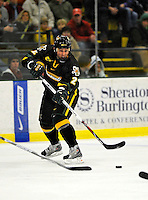 29 December 2007: University of Vermont Catamounts' defenceman Slavomir Tomko, a Senior from Zvolen, Slovakia, in action against the Holy Cross Crusaders at Gutterson Fieldhouse in Burlington, Vermont. The Catamounts rallied in the final seconds of play to tie the game 1-1. After overtime, although the official result remained a tie game, the Cats moved up to the championship round by winning a sudden death shootout in the second game of the Sheraton/TD Banknorth Catamount Cup Tournament...Mandatory Photo Credit: Ed Wolfstein Photo