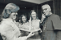 1978<br />  FILE PHOTO - ARCHIVES -<br /> <br /> Icing on the cake was . . . icing on the cake for Right Rev. Hugh Stiff; assistant Anglican Bishop of Toronto; as he takes a lick yesterday at a get-together celebrating his 25 years as a priest. Delighted baker holding church-shaped cake is Karen Henderson (left); 18; and sister; Debbie; 16. More than 300 people attended reception in St. James Cathedral after morning service. He also received a silver <br /> goblet.<br /> <br /> Bezant, Graham<br /> Picture, 1978,<br /> <br /> 1978<br /> <br /> PHOTO : Graham Bezant - Toronto Star Archives - AQP