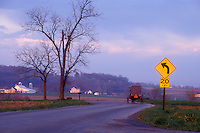 AJ1124, Amish, Pennsylvania, buggy, Lancaster County, Amish covered buggy traveling on a winding country road at dusk in Pennsylvania Dutch Country.