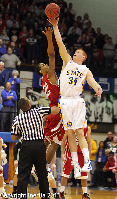 BROOKINGS, SD - JANUARY 12: Tony Fiegen #34 from South Dakota State tips off with Allen Saint-Gelais #22 from the University of South Dakota to start the first SDSU vs USD men's game since 2004. (Photo by Dave Eggen/Inertia)