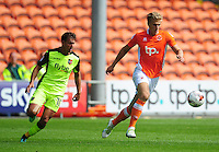 Blackpool's Brad Potts under pressure from Exeter City's Lee Holmes<br /> <br /> Photographer Kevin Barnes/CameraSport<br /> <br /> Football - The EFL Sky Bet League Two - Blackpool v Exeter City - Saturday 6th August 2016 - Bloomfield Road - Blackpool<br /> <br /> World Copyright © 2016 CameraSport. All rights reserved. 43 Linden Ave. Countesthorpe. Leicester. England. LE8 5PG - Tel: +44 (0) 116 277 4147 - admin@camerasport.com - www.camerasport.com