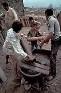 Children work in a ceramics facotry in Cario, Egypt. - Child labor as seen around the world between 1979 and 1980 - Photographer Jean Pierre Laffont, touched by the suffering of child workers, chronicled their plight in 12 countries over the course of one year.  Laffont was awarded The World Press Award and Madeline Ross Award among many others for his work.