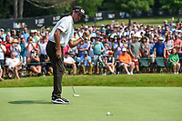 4th July 2021, Detroit, MI, USA;  Bubba Watson (USA) sinks his birdie putt on 18 during the Rocket Mortgage Classic Rd4 at Detroit Golf Club on July 4,