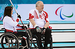 Sochi, RUSSIA - Mar 10 2014 -  Ina Forrest and Jim Armstrong during Canada vs USA in Wheelchair Curling round robin play at the 2014 Paralympic Winter Games in Sochi, Russia.  (Photo: Matthew Murnaghan/Canadian Paralympic Committee)