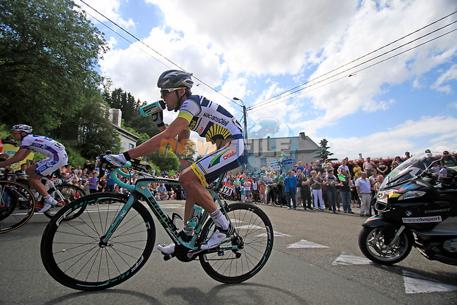 Rafael Valls Ferri (ESP) Vacansoleil-DCM grabs a drink as he rounds a hairpin to climb the Cote de Lierneux during Stage 1 of the 99th edition of the Tour de France, running 198km from Liege to Seraing, Belgium. 1st July 2012.<br /> (Photo by Eoin Clarke/NEWSFILE)