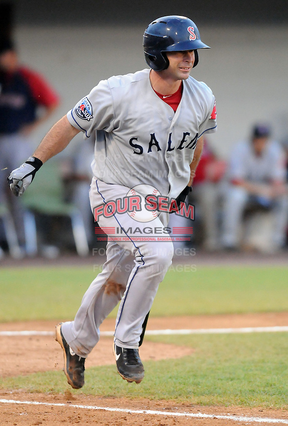 Catcher Dan Butler (12) of the Salem Red Sox, Carolina League affiliate of the Boston Red Sox, in a game against the Potomac Nationals on June 16, 2011, at Pfitzner Stadium in Woodbridge, Va. (Tom Priddy/Four Seam Images)