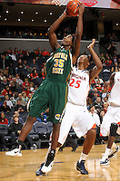 Dec. 20, 2010; Charlottesville, VA, USA; Norfolk State Spartans guard/forward Chris McEachin (35) shoots a basket in front of Virginia Cavaliers forward Akil Mitchell (25) during the game at the John Paul Jones Arena. Mandatory Credit: Andrew Shurtleff