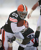 December 16th, 2007:  Buffalo Bills safety Jim Leonhard (43) tackles Cleveland Browns running back Jason Wright (29) at Cleveland Browns Stadium in Cleveland, Ohio.  The Browns shutout the Bills 8-0 to inch closer to clinching a playoff spot.  Photo Copyright Mike Janes Photography.