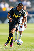 CARSON, CA - MAY 8: Eddie Segura #4 of LAFC moves with the ball during a game between Los Angeles FC and Los Angeles Galaxy at Dignity Health Sports Park on May 8, 2021 in Carson, California.