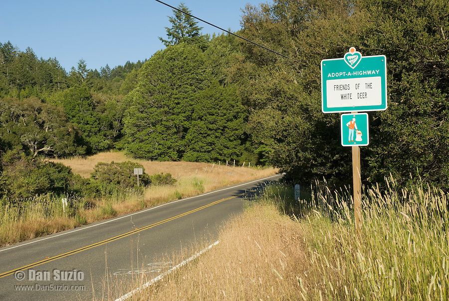 Adopt-a-Highway sign on State Highway 1 in Marin County, California.  Friends of the White Deer is an organization opposed to the National Park Service's plans to eliminate non-native fallow and axis deer from Point Reyes National Seashore.
