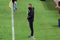 NASHVILLE, TN - SEPTEMBER 23: Head coach Ben Olsen of DC United watches from the technical area during a game between D.C. United and Nashville SC at Nissan Stadium on September 23, 2020 in Nashville, Tennessee.