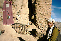 A Hazara living with is family in a cave (former Buddhist temple) in the cliff on the left of the 54 meters Bamiyan Buddha.