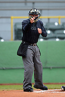 Umpire Nestor Ceja makes a call during a game between the Clinton LumberKings and Quad Cities River Bandits May 26, 2013 at Ashford University Field in Clinton, Iowa.  Quad Cities defeated Clinton 5-2.  (Mike Janes/Four Seam Images)
