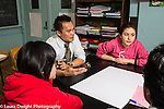 Education high school Group of students in science class discussion about medical ethics question, guided by male teacher