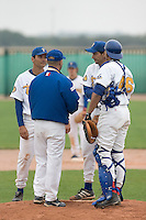 10 Aug 2007: Team manager Didier Seminet talks to pitcher Samuel Meurant next to David Meurant and Ernesto Martinez during game 1 of the french championship finals between Templiers (Senart) and Huskies (Rouen) in Chartres, France. Templiers beat Huskies 1-0.