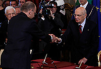 Il Presidente del Consiglio Enrico Letta stringe la mano al Presidente della Repubblica Giorgio Napolitano, a destra, alla cerimonia del giuramento del nuovo governo al Quirinale, Roma, 28 aprile 2013..Italian Premier Enrico Letta shakes hands with Head of State Giorgio Napolitano, right, during the swearing in ceremony of the new government at the Quirinale presidential palace Rome, 28 April 2013..UPDATE IMAGES PRESS/Isabella Bonotto