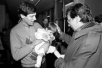 December 19, 1987 File Photo - Montreal, Quebec, CANADA -  Robert Bourassa, Quebec Premier attend Sun Youth fundraiser pasta supper.<br /> <br /> In photo : Jacques Chagnon and his baby ( L) and  Robert Bourassa, (R)