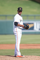 Salt River Rafters relief pitcher Miguel Del Pozo (38) of the Miami Marlins organization, prepares to deliver a pitch to the plate during an Arizona Fall League game against the Mesa Solar Sox on October 30, 2017 at Salt River Fields at Talking Stick in Scottsdale, Arizona. The Solar Sox defeated the Rafters 8-4. (Zachary Lucy/Four Seam Images)