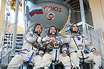 At the Gagarin Cosmonaut Training Center in Star City, Russia, Expedition 38/39 Flight Engineer Koichi Wakata of the Japan Aerospace Exploration Agency (left), Soyuz Commander Mikhail Tyurin (center) and NASA Flight Engineer Rick Mastracchio (right) clasp hands in front of a Soyuz simulator Oct. 17, 2013 as they conducted final qualification exams. The trio is scheduled to launch on Nov. 7, local time, from the Baikonur Cosmodrome in Kazakhstan on the Soyuz TMA-11M spacecraft for a six-month mission on the International Space Station.<br /> <br /> NASA/Stephanie Stoll