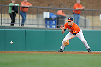 Virginia Cavaliers third baseman Nick Howard #33 fields a ball during a game against the Clemson Tigers at Doug Kingsmore Stadium on March 15, 2013 in Clemson, South Carolina. The Cavaliers won 6-5.(Tony Farlow/Four Seam Images).