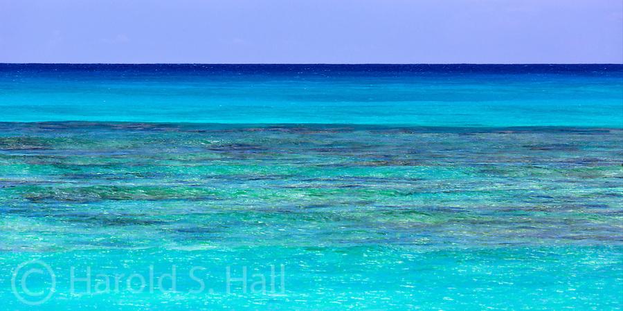 The azure blues of the Pacific Ocean off the coast of the famed Waikiki Beach in Honolulu, Oahu Hawaii.