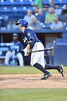 Asheville Tourists shortstop Ryan Vilade (4) swings at a pitch during a game against the Greensboro Grasshoppers  at McCormick Field on May 10, 2018 in Asheville, North Carolina. The Tourists defeated the Grasshoppers 9-3. (Tony Farlow/Four Seam Images)