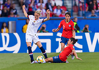 PARIS,  - JUNE 16: Emily Sonnett #14 is tackled by Rosario Balmaceda #21 during a game between Chile and USWNT at Parc des Princes on June 16, 2019 in Paris, France.