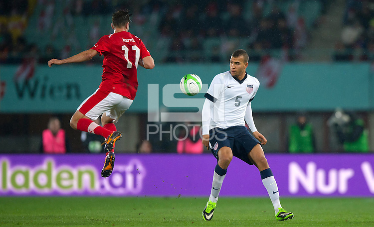 VIENNA, Austria - November 19, 2013: John Anthony Brooks and Austria's Martin Harnik during a 0-1 loss to host Austria during the international friendly match between Austria and the USA at Ernst-Happel-Stadium.