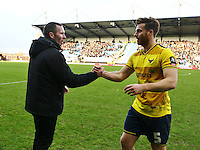 Michael Appleton manager of Oxford United shakes hands with John Mullins of Oxford United  after the match   during the Emirates FA Cup 3rd Round between Oxford United v Swansea     played at Kassam Stadium  on 10th January 2016 in Oxford