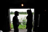 Miner Todd Bauer talks to conductor Charles Baldwin on board the Hurricane Turn train. The Alaska Railroad's Hurricane Turn is one of America's last true whistlestop trains.