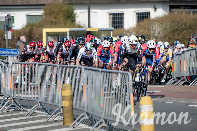 peloton speeding towards a bunch sprint<br /> <br /> 45th Oxyclean Classic Brugge-De Panne 2021 (ME/1.UWT)<br /> 1 day race from Bruges to De Panne (204km)<br /> <br /> ©kramon