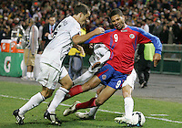 Steve Cherundolo #6 and Jose Francisco Torres #14 of the USA knock Alvaro Saborio #9 of Costa Rica off the ball during a 2010 World Cup qualifying match in the CONCACAF region at RFK Stadium on October 14 2009, in Washington D.C.The match ended in a 2-2 tie.