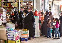 Rissani, Morocco.  Market Scene, Women Shopping.