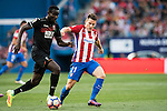 Kevin Gameiro (r) of Atletico de Madrid fights for the ball with Victorien Angban of Granada CF during their La Liga match between Atletico de Madrid and Granada CF at the Vicente Calderon Stadium on 15 October 2016 in Madrid, Spain. Photo by Diego Gonzalez Souto / Power Sport Images