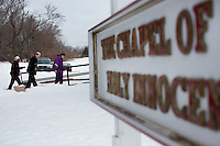 A caregiver, Jack Walsh (center) and Marilyn Davidson (right) walk to the Chapel of Holy Innocents at the Fernald Developmental Center in Waltham, Massachusetts, USA.